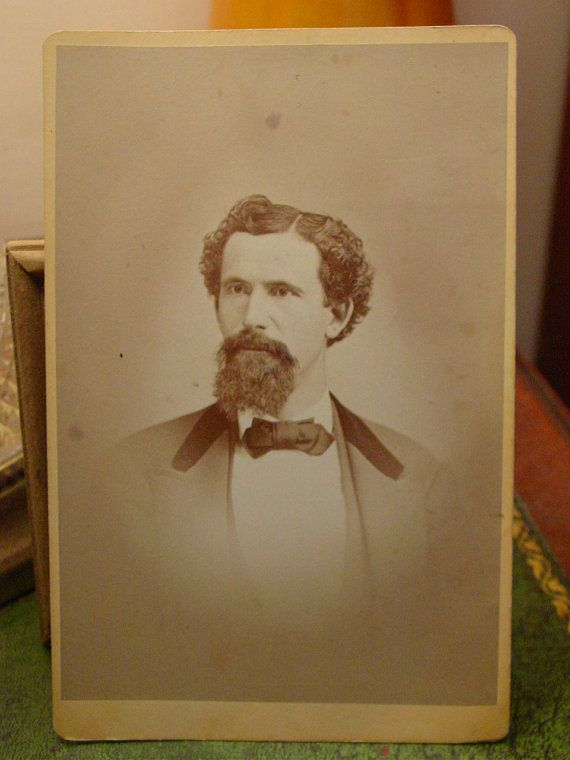 Wonderful cabinet photo of a handsome, mustachioed man. On the back is handwritten:  Mineworker at Pine Flat Chas Wheeler  . Pine Flat is near