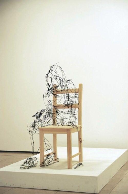 David Oliveira - aPortugueseartists specialising in wire sculpture work. Half 2D sketchbook, half 3D emotive portrait.