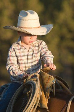 Reminds me so much of my son Ryan when he was little. He was always out helping his Daddy round up cattle :-)