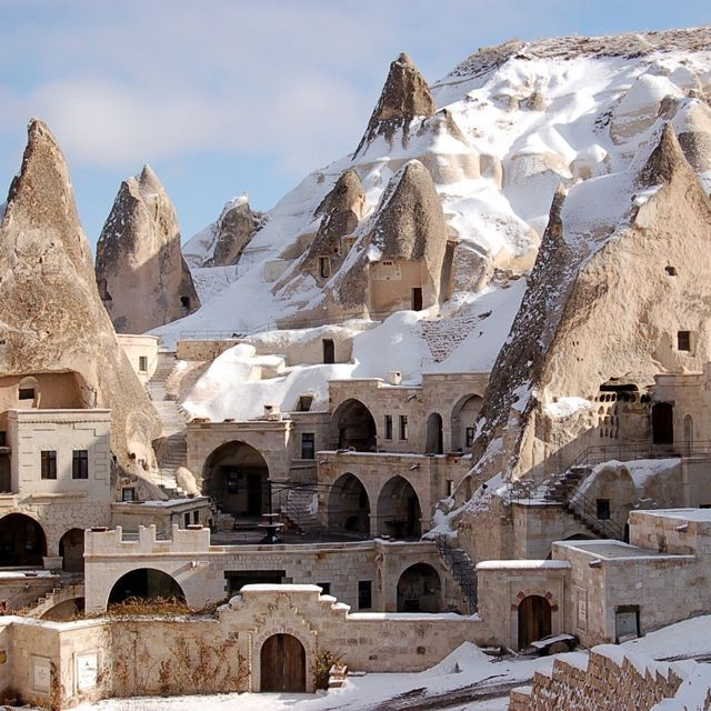 Cave houses (and hotels) in snowy Cappadocia, Turkey.