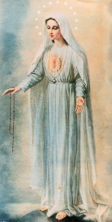 Our Lady with the moon under her feet, the Immaculate Heart on her chest, and the rosary in her hand.