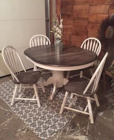 From simple Oak Table and Chairs to a Decorative Rustic Dining Set. This charming set was given new life with Snow White Milk Paint and Pitch Black Glaze Effects. A pretty combination of Black/Grey and White.