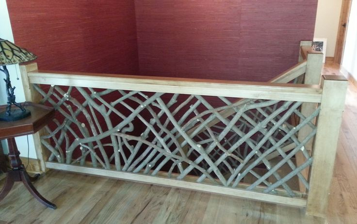 This custom railing used woven rhododendron with traditional maple stair parts.  The perfect rustic touch for a traditional mountain home.