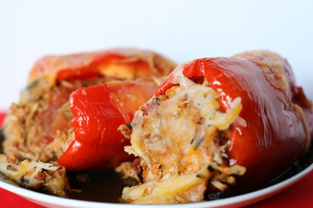 Mexican Pulled Chicken Stuffed Peppers. Easy and simple crock pot recipe - chicken breasts, jalapeños, tomatoes, onions, green peppers, any color bell pepper you want to bake it in, salsa, cheese and taco seasoning.  This sounds good!!! #paleo