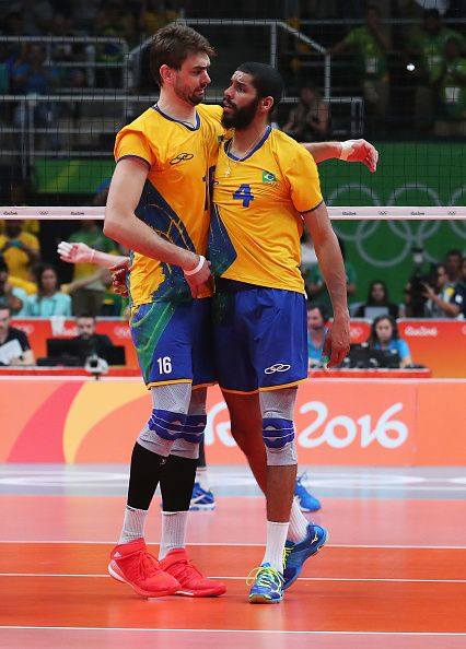 Wallace de Souza of Brazil is congratulated by team mate during the Men's Gold…