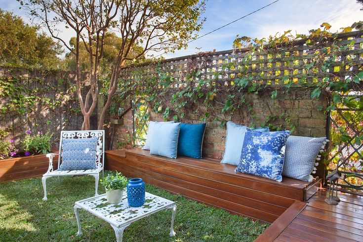 Private rear garden, built-in seating, throw cushions, outdoor table & chair, lattice, Pilcher Residential