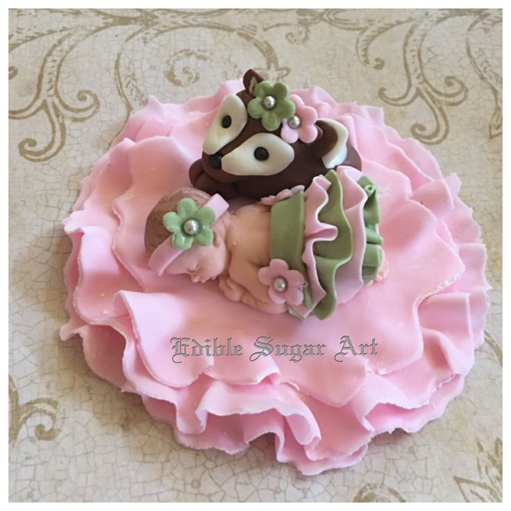 """Fondant baby shower cake topper includes: 1 Fondant baby 2 1/2"""" long in ruffle skirt in light sage and light pink 1 fondant deer 1 4"""" blanket ruffle FAQ Please read prior to purchase. Thanks! :~) ~PLE"""
