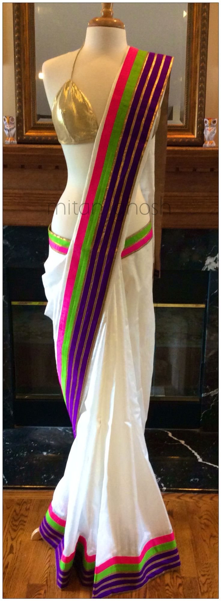 Raw silk Saree. Comes with a purple raw silk unstitched blouse piece.