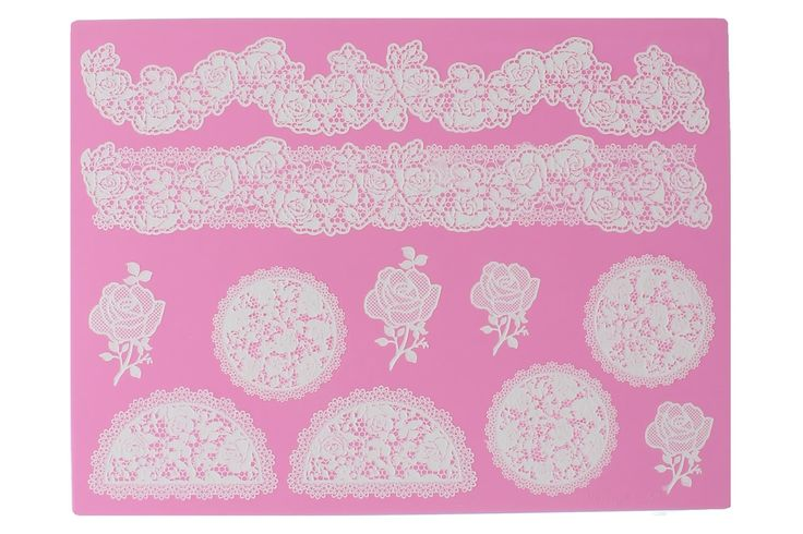 The Vintage Rose Cake Lace mat is a modern redesign of a traditional vintage floral design. The roses can be used as cupcake toppers, and the floral drapes as a