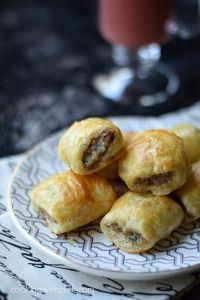 Puff Pastry Sausage Rolls      1 organic egg     1 Pound MSG-free pork sausage     1/4 fine bread crumbs     1 teaspoon onion powder     1 teaspoon garlic powder     1 teaspoon dry mustard     2 Tablespoons chopped Italian parsley     1 box Pepperidge Farms Puff Pastry (2 sheets)     egg wash     1 organic egg     1 Tablespoon water