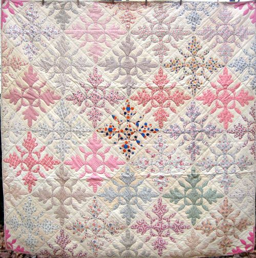 """The quilt pattern is called """"Oak leaf and reel"""" or sometimes just oak leaf. It was more common in the later 1800's when it was usually just red or blue on white, sometimes red & green on white."""