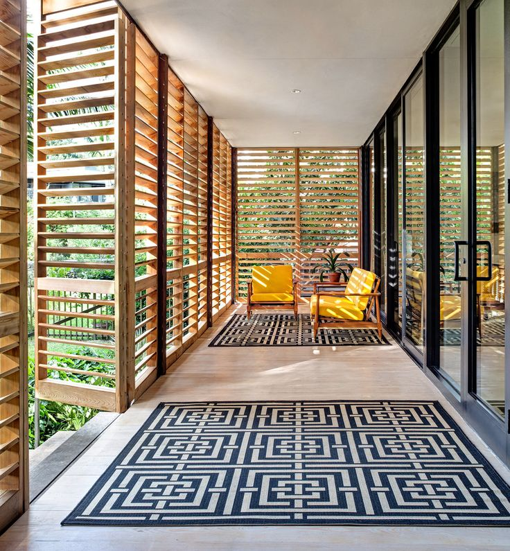 The 800-square-foot porch has cypress floors covered with indoor-outdoor rugs from Safavieh that the couple bought on Overstock.com (about $77 and $116). The midcentury chair and loveseat are from Ms. Brillhart's family.