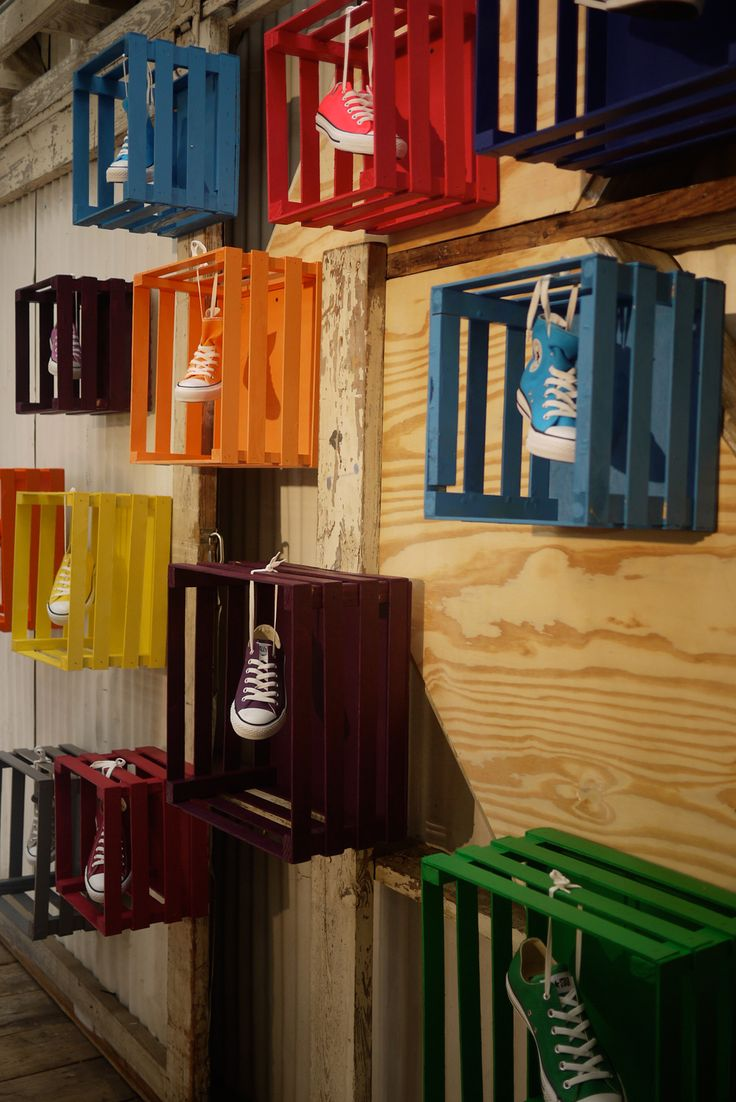 Colourful shoe crates as shoe display. #retail #merchandising #display #repurpose #reuse #shoes