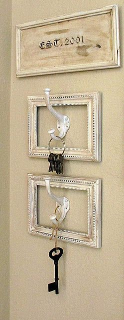Cute idea for keys, purses, etc. All you need is hooks, frames, and spray paint. Great idea.