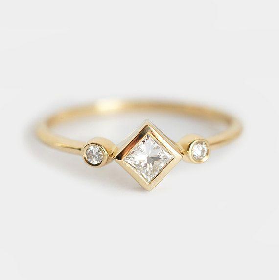 Bague en diamant princesse trois anneau de Pierre par capucinne