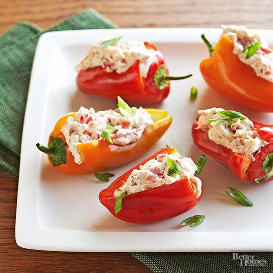 Your guests will love these low-calorie stuffed peppers. A spicy cream cheese spread packed with chipotle peppers, green onion, and tomato fills this top-rated recipe./