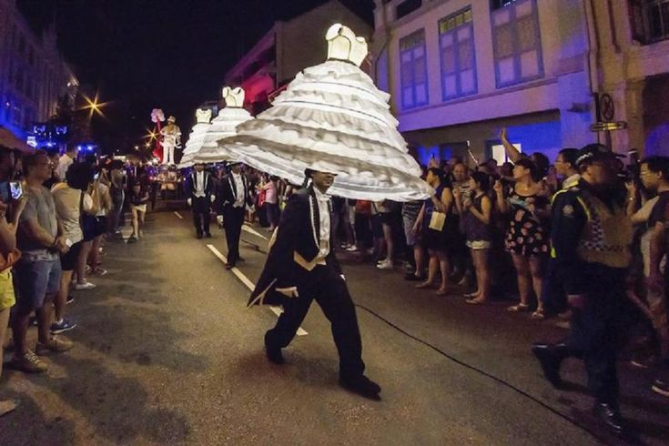 Musical grooms carry their floating luminous dresses and dance with them...  #brassband #grooms #luminous #dresses #music