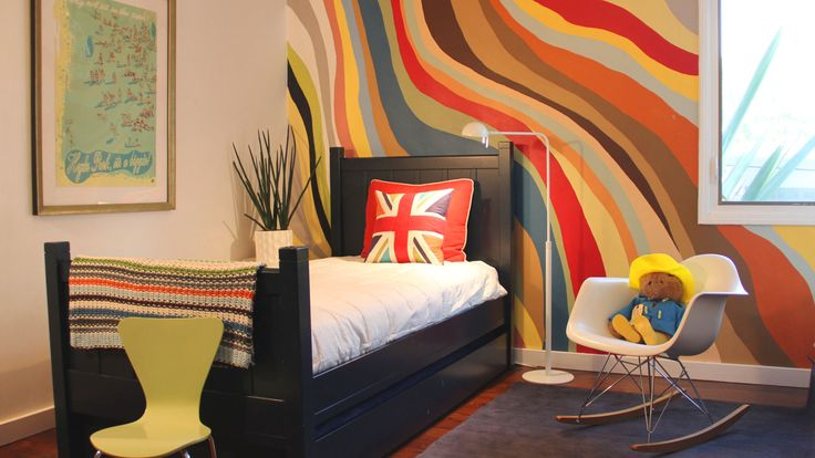 Cool Painting Ideas: Instead of the usual stripes, try something different like waves. They're more eye-catching and let you use more than two contrasting colors. You can freehand them and make the wall look like an abstract painting. A great way to connect all the other color accents you've used throughout the room.