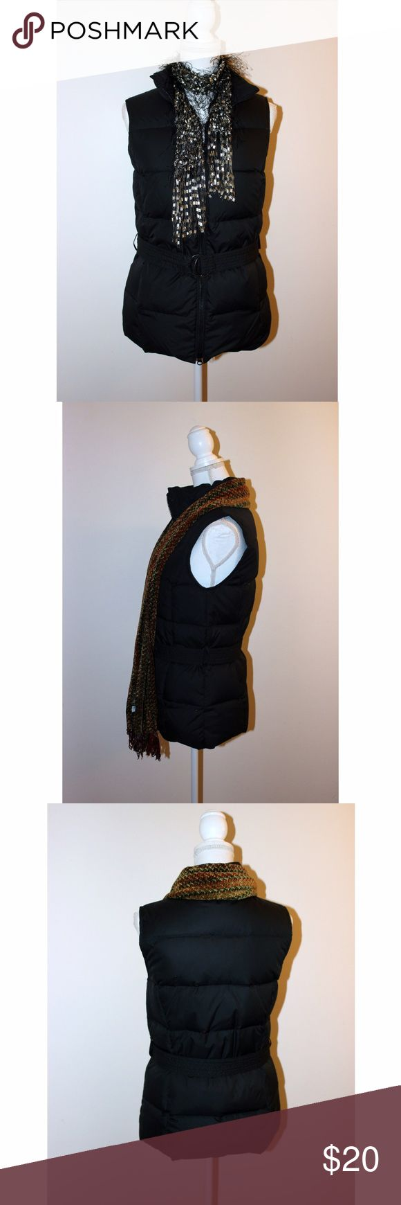"""Down-Filled Belted Black Vest from the Gap Look great and keep warm in this vest from the Gap. It has a front zip, belt, and side pockets. The shell and lining are polyester, and it is down-filled. Measurements: Armpit to armpit 17.5"""" - Waist 36"""" - Hips 39"""" - Length 25"""". It is new without tags from the Gap and is size Small. GAP Jackets & Coats Vests"""