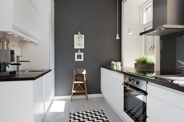 Love the contrast between the glossy white units and the dark grey wall.