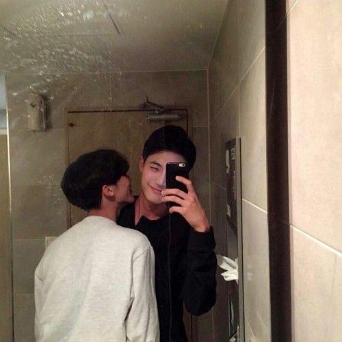 gay kiss selfie