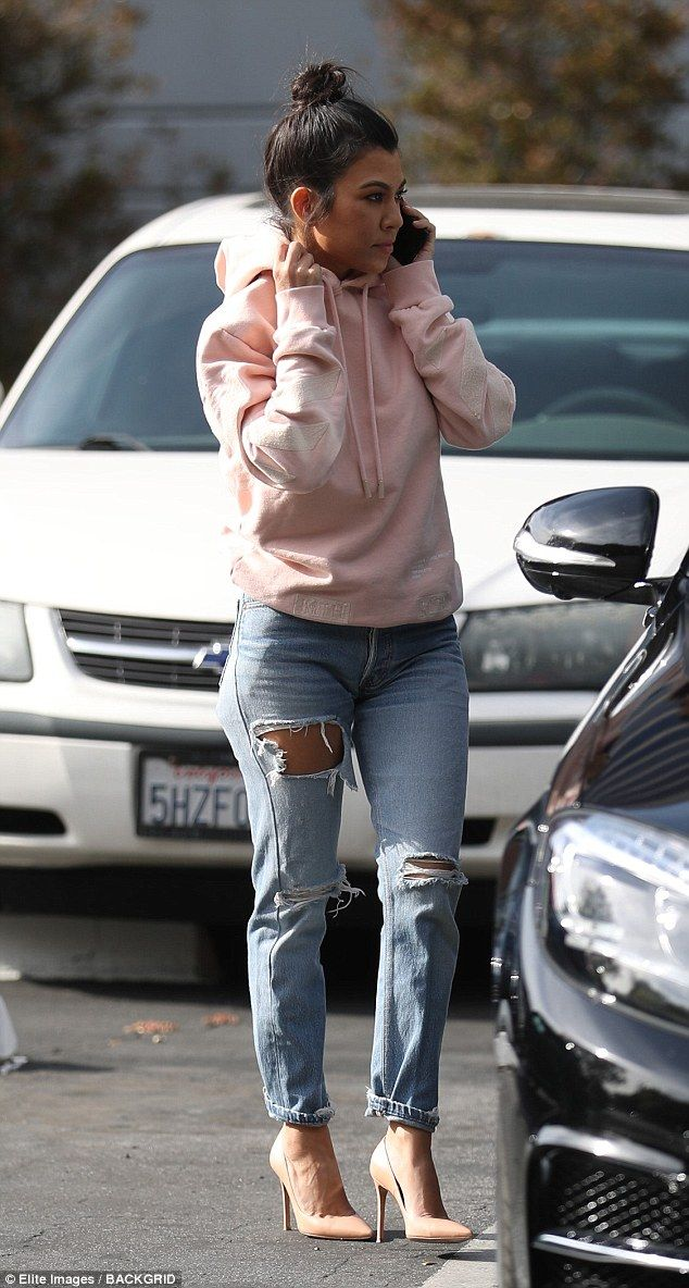 Multi-tasking: Kourtney also took a phone call while running errands...