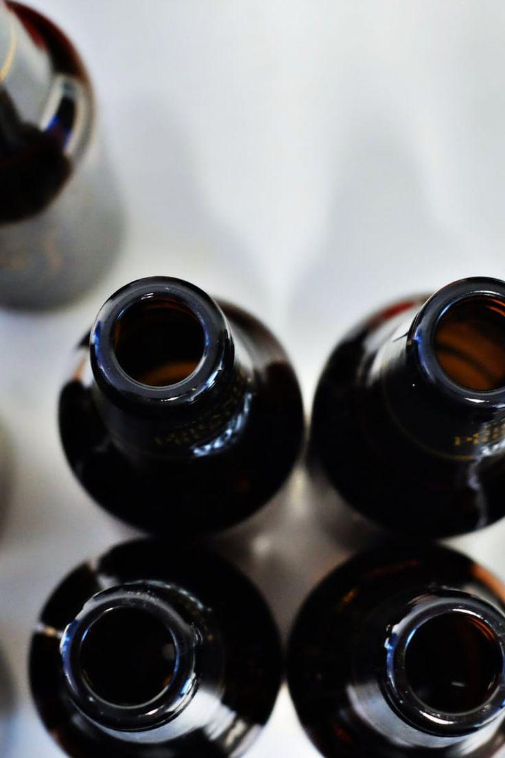 Black Bottles on White Surface