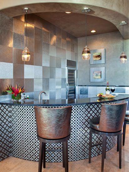 Large square metal wall as a kitchen backsplash idea... Dramatic Contemporary Bar by Lori Carroll