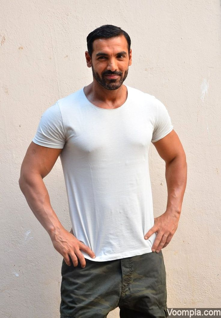White hot! John Abraham looks super cool in a T-shirt and cargos. via…
