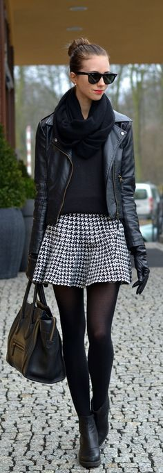 Black leather jacket, tartan skirt and black scarf