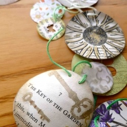 A package of gifts from Britain, with a handmade paper garland inspired by The Secret Garden.