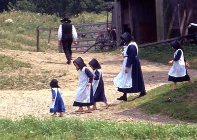 Amish family; note how the children are not wearing shoes