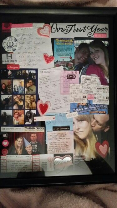 Shadow box of our first year together. Notes, pictures, movie stubs and other trinkets. Our way of show casing our relationship.