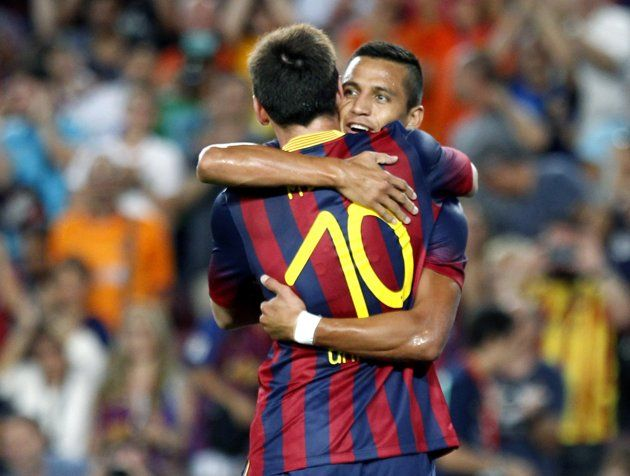 Barcelona's Alexis celebrates his goal as he hugs his team mate Lionel Messi during the Joan Gamper trophy soccer match against Santos in Barcelona