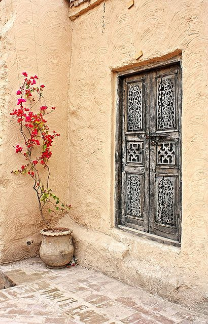 Saidpur Village: pink bougainvillea, brushed mud walls and weathered carved wood
