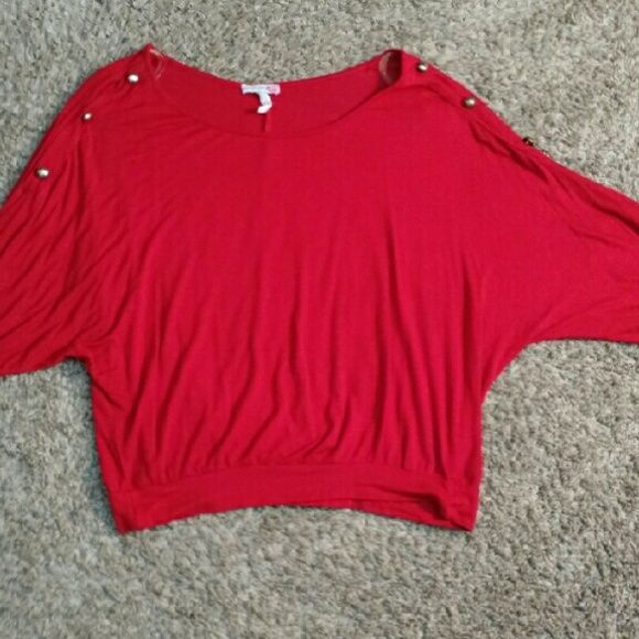 Body Central Red Batwing 3/4 Sleeve Blouse Loose-fitting and soft Body Central red batwing blouse with 3/4 sleeves. Three gold button detail on both sleeves. Medium but can fit large. No stains or tears, but she damage to the clear straps that hold the shirt to the hanger as pictured above. Closet closing 8/25/16 due to college Body Central Tops