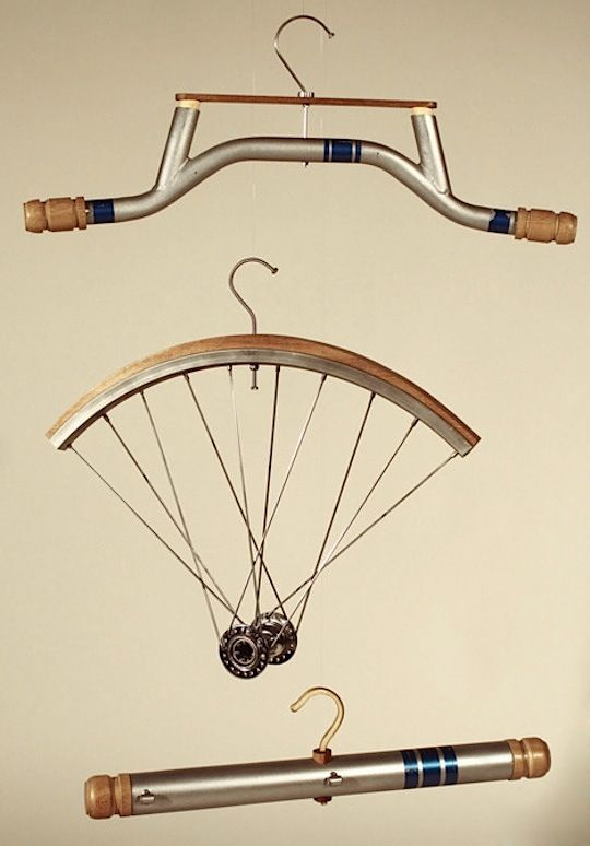 neat bike related clothes hangers from Oliver Staiano, a student in Nottingham Trent University's Product Design program. . Fashioned from old bikes and some wood finishing, this trio has all sorts of personality and promise (extra nice touch: the hook for each hanger is made from a spoke)