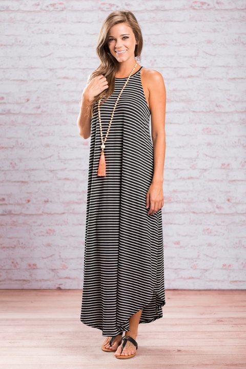 So, it's safe to say that maxi dress is ready to set sail! We love it's classic stripes, it's comfy, loose cut and how the hemline is higher on the sides! This maxi dress is honestly perfect for almost anything! You can rock this beauty while shopping, on vacation, on a date or even on a boat! We suggest adding a fun pop of color with a necklace and keeping it low key with some chic gladiators!