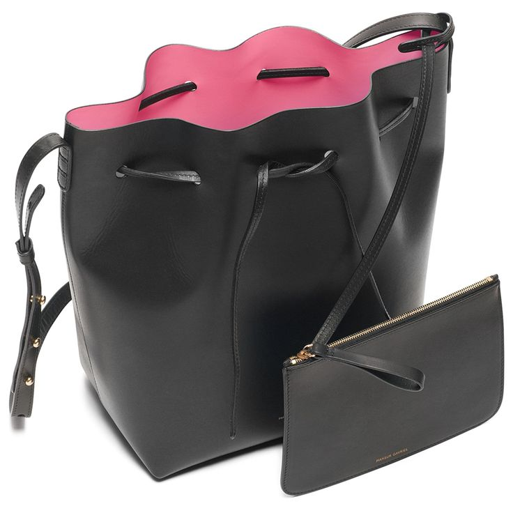 Italian vegetable tanned leather black bucket bag with red interior matte patent. Detachable wallet and adjustable strap. Made in Italy.