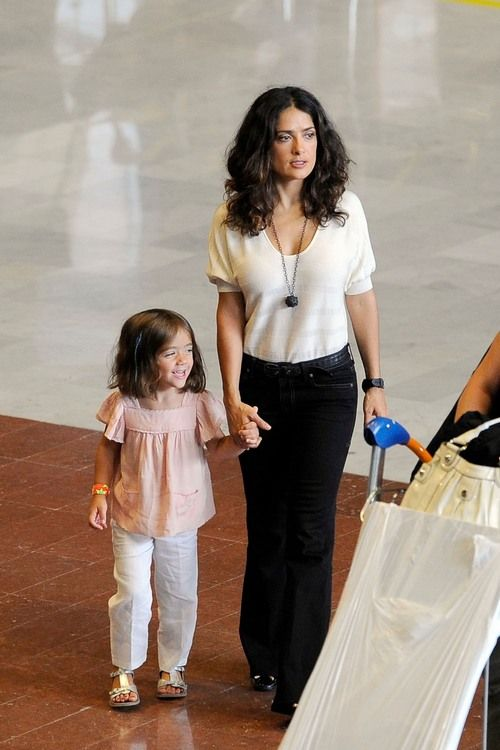 Salma Hayek and her young daughter Valentina return from their US family vacation
