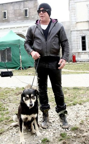 "Mickey Rourke- great actor with a soft spot for dogs. Here he is pictured with ""Foxy"", a Romanian stray, whom he rescued while filming. After learning of the ""stray problem"" in Romania Mickey committed to forming ""Wild Dogs of Romania Sanctuary"". <3 him!!"