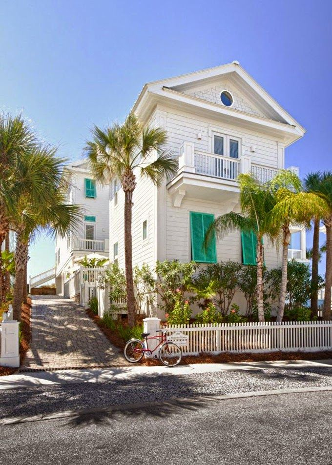 beach house with turquoise shutters