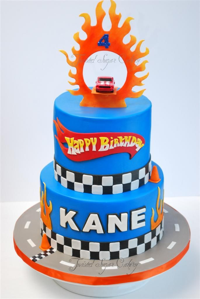 Children's Birthday Cakes - Hot Wheels theme birthday cake. Real toy car on top.