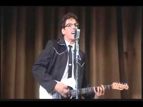 Gary Busey plays Buddy Holly at the movie The Buddy Holly Story