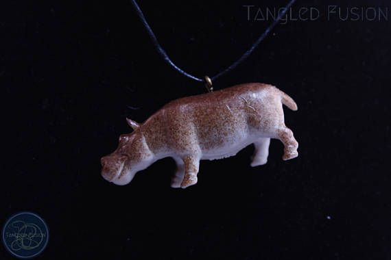Quirky Handmade Adjustable Animal Necklace on Leather  Design: Hippo      Tangled Fusion offers a wide scope of quirky, fun jewellery and handmade creations.  https://www.etsy.com/au/listing/524266200/quirky-handmade-adjustable-animal?ref=shop_home_active_6