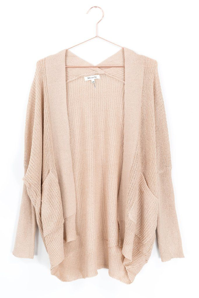 """Lightweight sweater knit cardigan with a slouchy/loose fit. Fitted ribbed knit long sleeves. Dropped shoulder. Size S/M measures approx. 25"""" in length. Colors"""