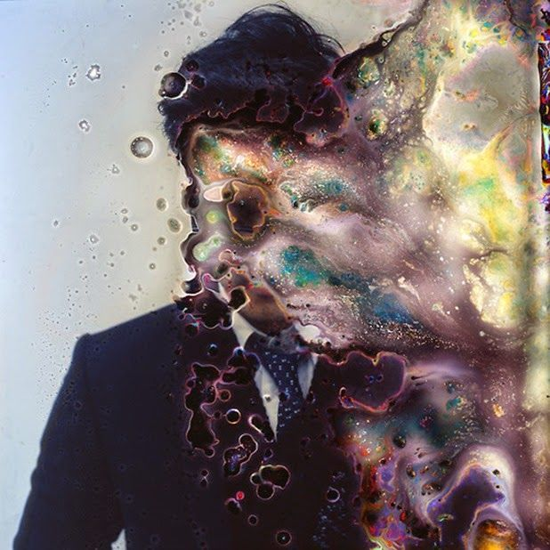 """Impermanence"" is a series of portraits by Korean photographer and microbiologist Seung-Hwan Oh who drowns his films camera before using them, into a cultivation of fungus mushrooms. The bacterias devour the film for an abstract and destroyed result. A beautiful way to mistreat a film and to rebel against the perfect and idealized pictures we see everywhere nowadays."