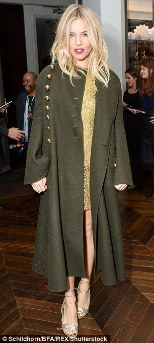 Seasonally stylish: The actress donned a funky olive military-style great coat to top her ...