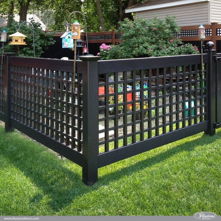 Amazing Low Maintenance Fence Idea: Black PVC Vinyl Old English Lattice Fence with New England Caps from /illusionsfence/ is the perfect garden fence. #garden #fence #fenceideas backyardideas