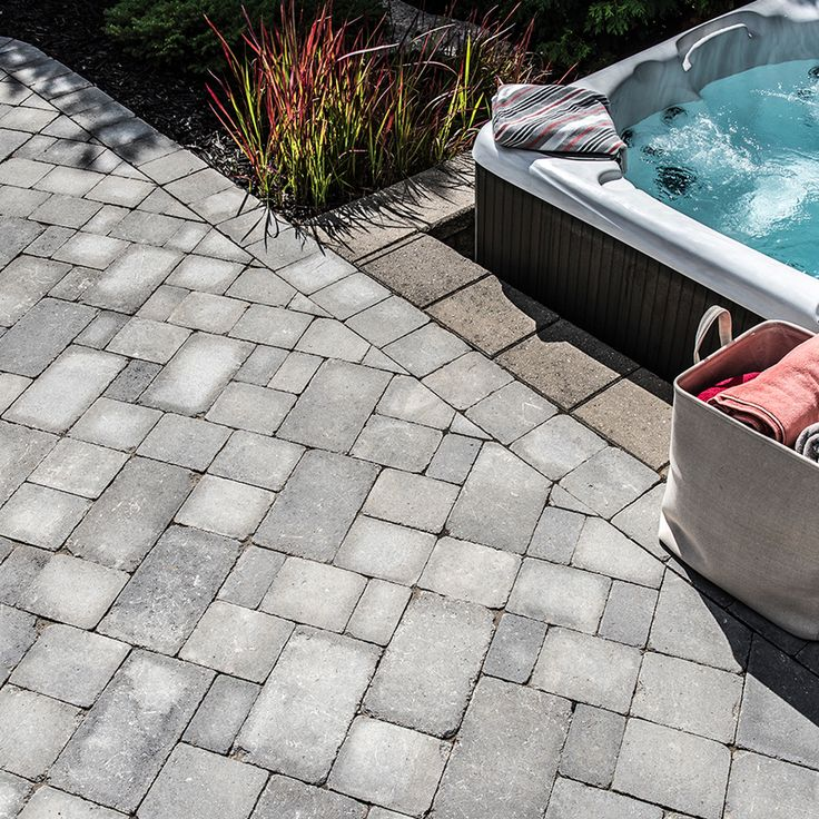 Poolside landscape. Project application using Wexford pavers. Color: Wexford Grey Granite by Oaks Landscape Products.